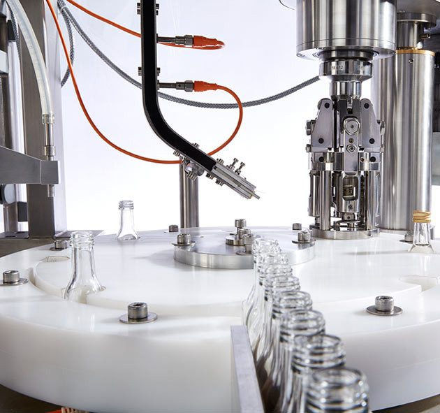 Mini Monoblock volumetric rotary filling machine complete with integrated capping machine